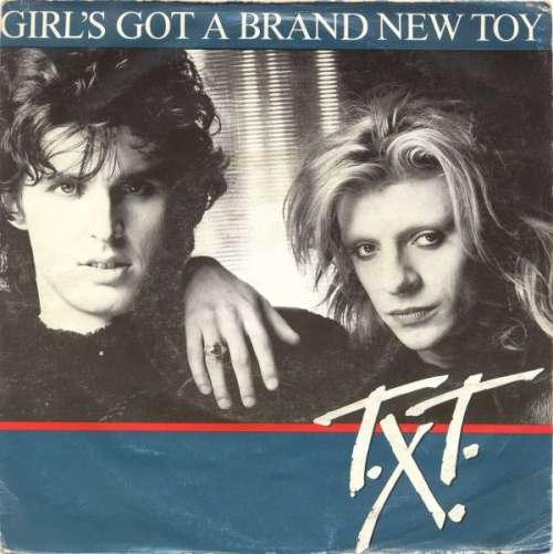 Bild T.X.T. - Girl's Got A Brand New Toy (7, Single) Schallplatten Ankauf