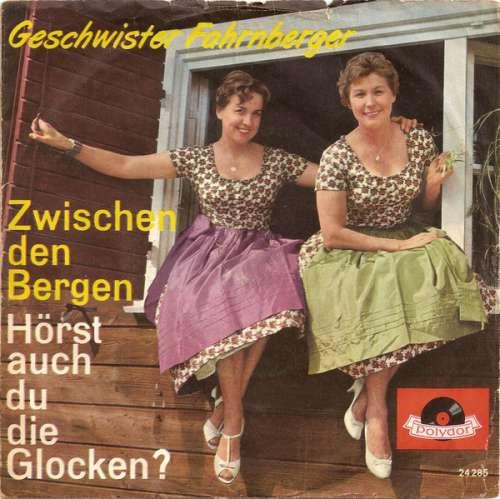 Bild Die Geschwister Fahrnberger - Zwischen Den Bergen / Hörst Auch Du Die Glocken? (7, Single) Schallplatten Ankauf