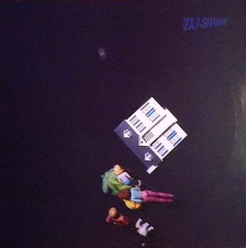 Cover DJ Shadow - Midnight In A Perfect World (12, Single) Schallplatten Ankauf
