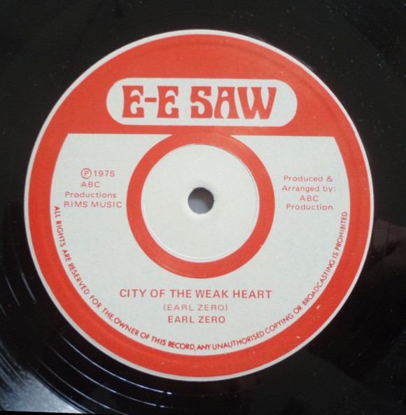 Cover King Tubby & Jacob Miller - E-E Saw Dub (LP) Schallplatten Ankauf