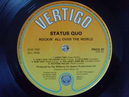 Bild Status Quo - Rockin' All Over The World (LP, Album, RE) Schallplatten Ankauf